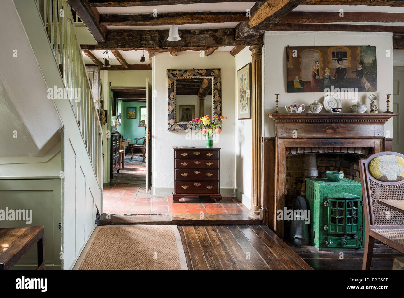 Wooden drawers and green stove in cottage entrance, once home to Virgina Wolfe - Stock Image