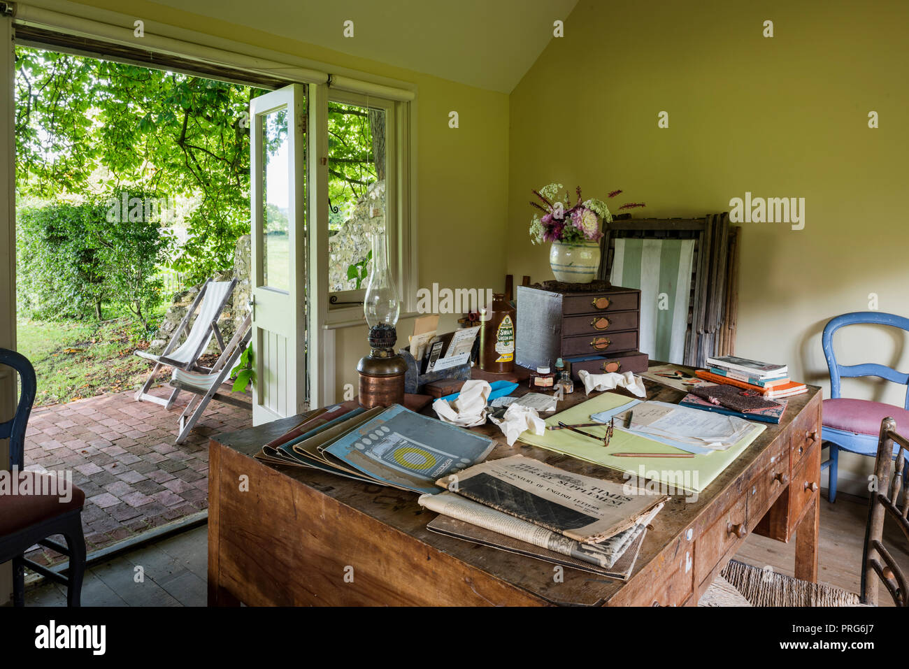 Newspaper on desk in summerhouse, once home to Virgina Wolfe - Stock Image