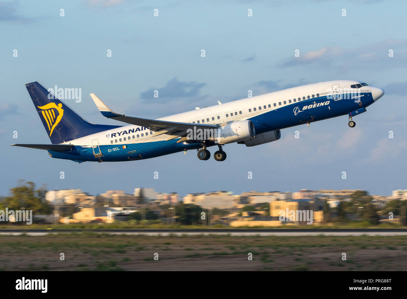 Ryanair Boeing 737-8AS [REG: EI-DCL] in special Boeing colors, taking off in the late evening. - Stock Image