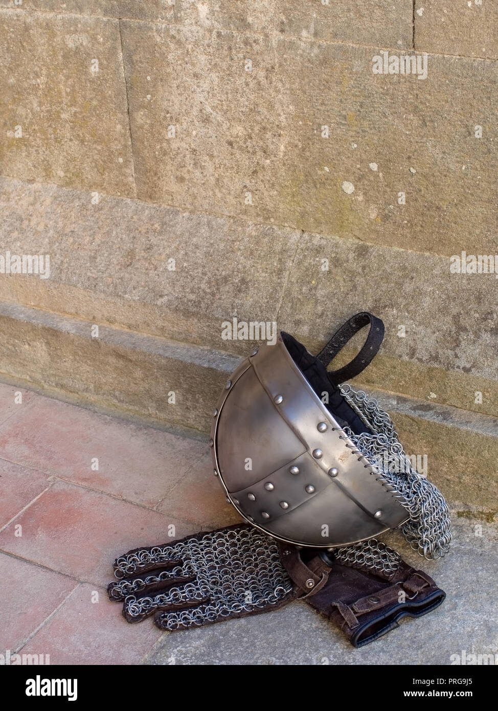 Medieval, mediaeval knight helmet and chain mail gloves. - Stock Image