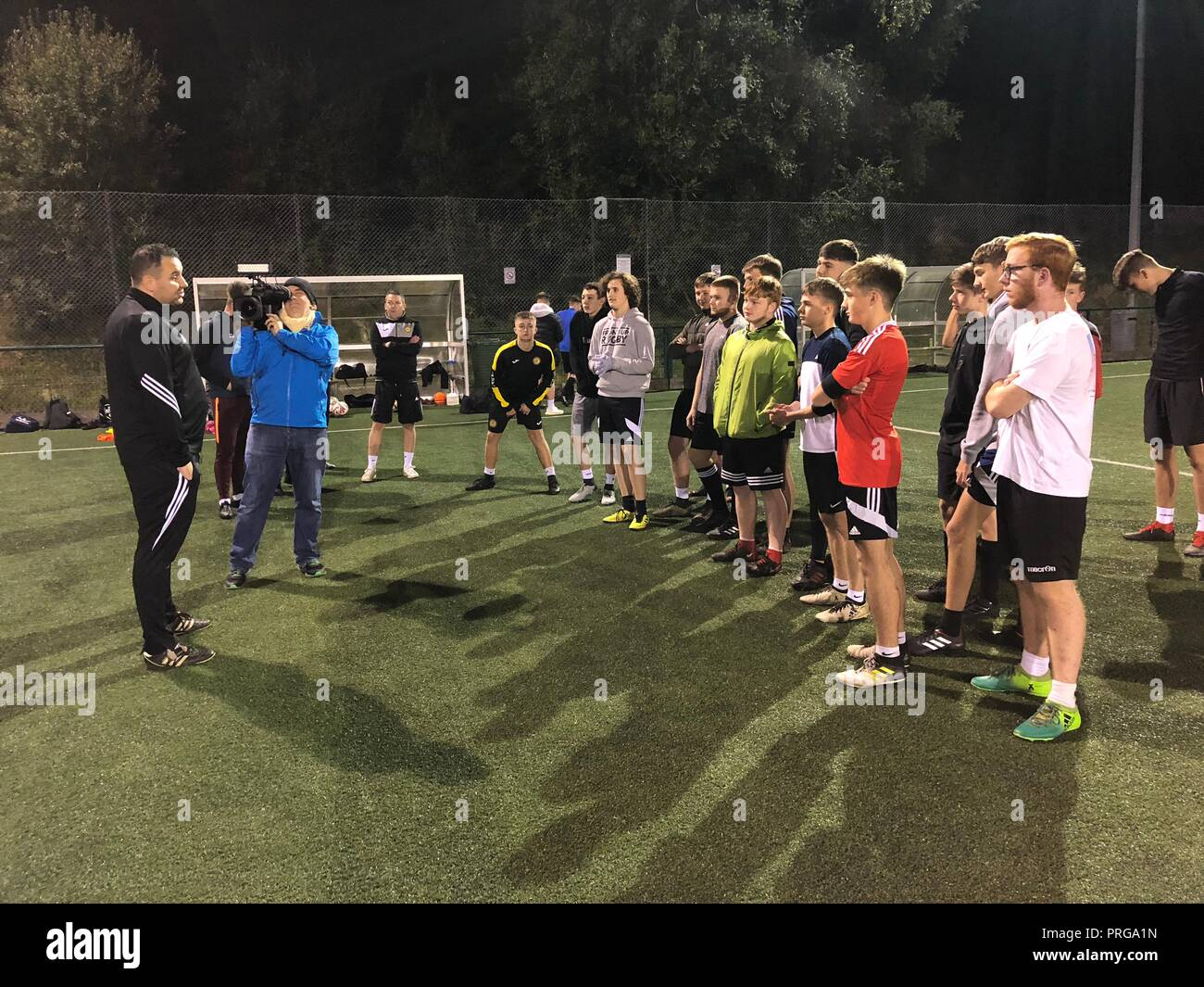 Ynysddu Welfare Club Secretary Ben Murphy speaks to prospective youth players at Pontllanfraith Leisure Centre, Blackwood. Stock Photo
