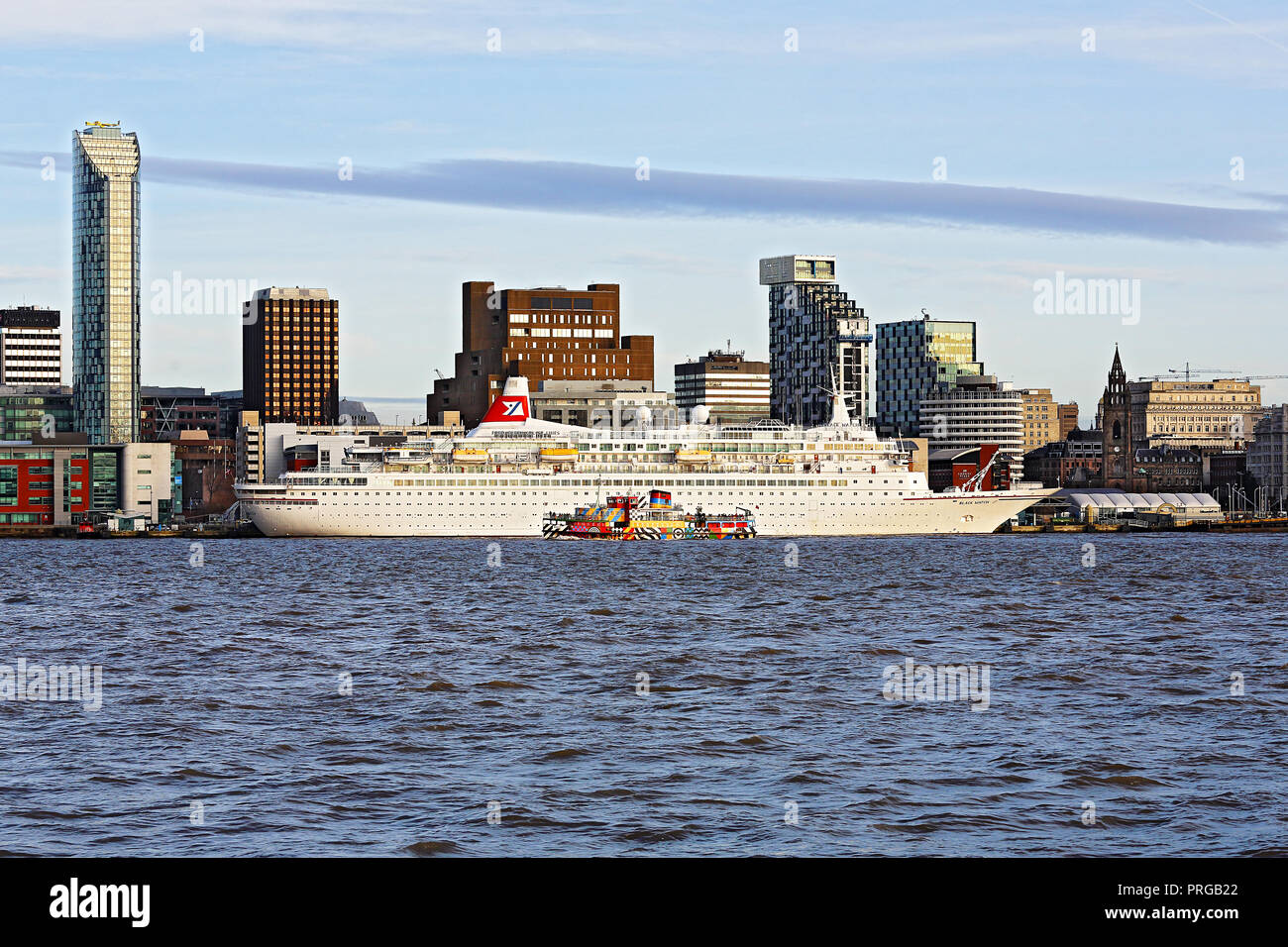 Mersey Ferry Snowdrop sailing past Cruise Ship Black Watch moored at the Pier Head landing stage on the River Mersey Liverpool UK December 51101 - Stock Image