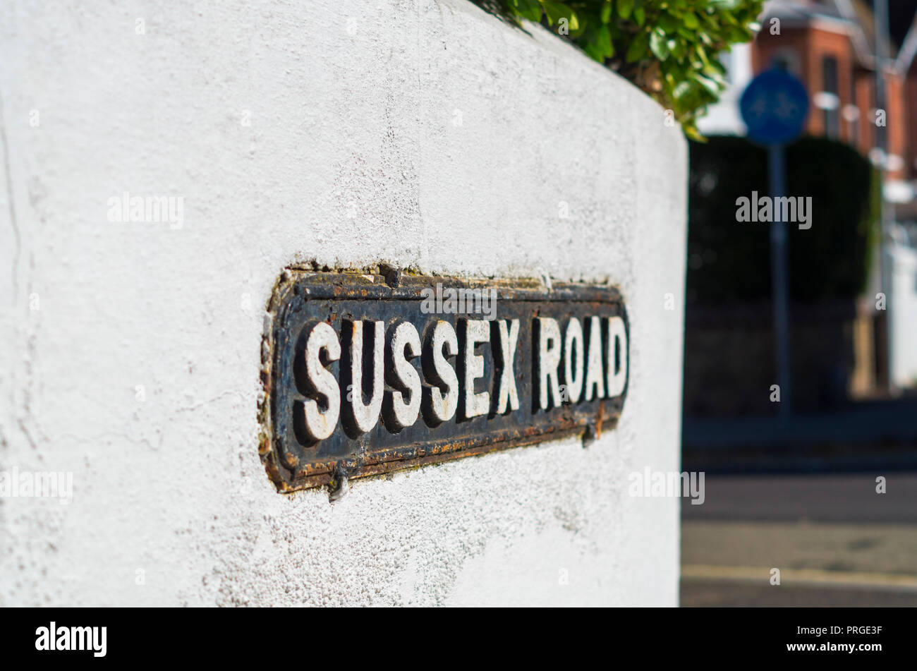 Sussex Road street name plate on wall in Worthing, West Sussex UK. - Stock Image