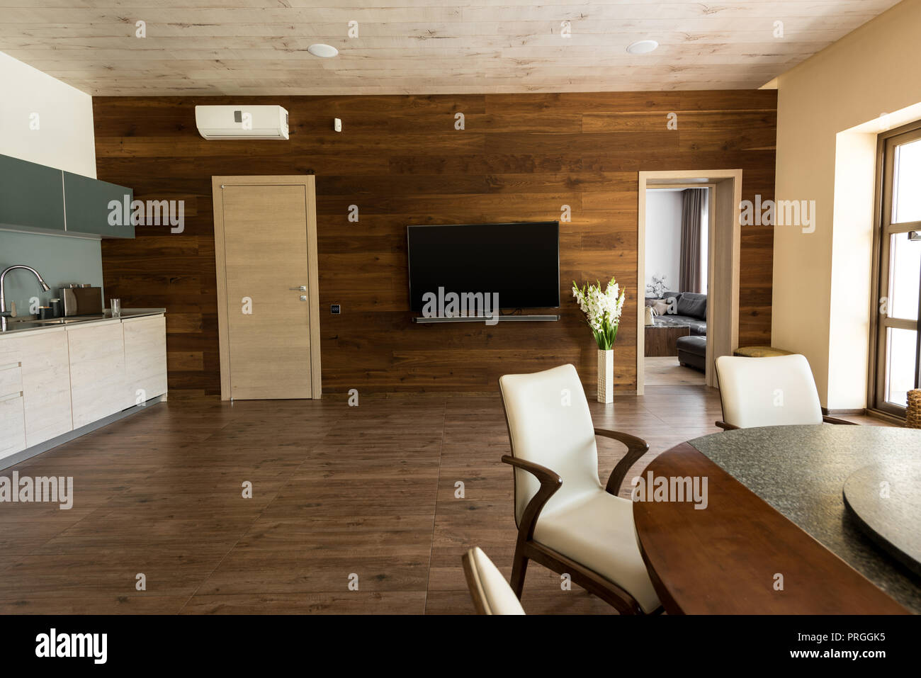 Interior Of Modern Kitchen And Dining Room With Table Chairs And Tv Set Stock Photo Alamy