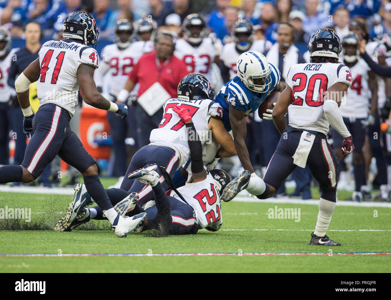 September 30, 2018: Houston Texans linebacker Brennan Scarlett (57) and Houston Texans defensive back Aaron Colvin (22) tackle Indianapolis Colts wide receiver Zach Pascal (14) during NFL football game action between the Houston Texans and the Indianapolis Colts at Lucas Oil Stadium in Indianapolis, Indiana. Houston defeated Indianapolis 37-34 in overtime. John Mersits/CSM. - Stock Image
