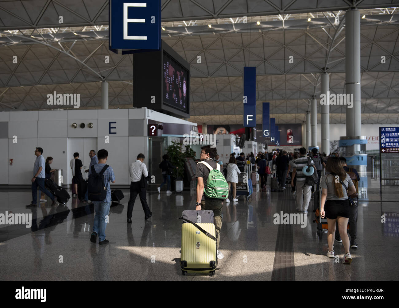 Chek Lap Kok island, Hong Kong. 1st Jan, 2014. Passengers are seen walking through Hong Kong's terminal 1 where different airline check-in desk are located. Credit: Miguel Candela/SOPA Images/ZUMA Wire/Alamy Live News - Stock Image