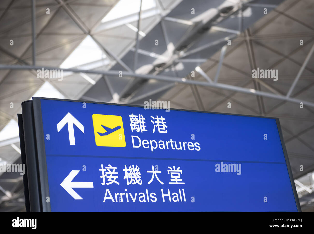 Chek Lap Kok island, Hong Kong. 28th Sep, 2018. A sign post is seen at Hong Kong airport giving direction of the location of the departure and arrival hall. Credit: Miguel Candela/SOPA Images/ZUMA Wire/Alamy Live News - Stock Image