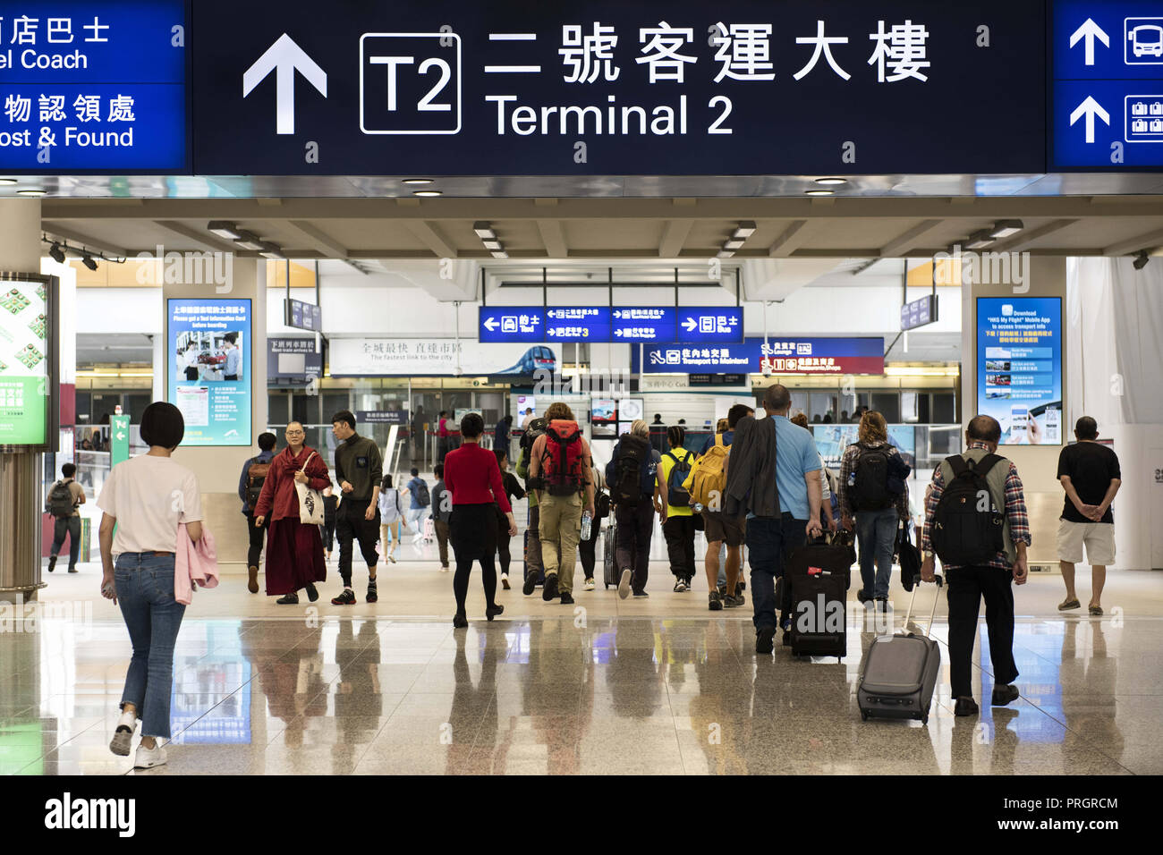 Chek Lap Kok island, Hong Kong. 28th Sep, 2018. Passengers are seen walking through Hong Kong's terminal 1 exit where it connects with terminal 2 and MTR subway line to the city. Credit: Miguel Candela/SOPA Images/ZUMA Wire/Alamy Live News - Stock Image