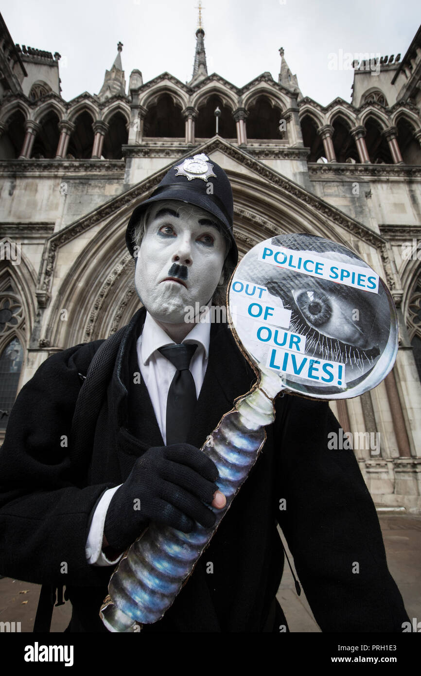 London, UK. 3rd Oct 2018. Protester Against Undercover Police Officers outside High Court, Royal Courts of Justice, London, UK 3rd October 2018. The public have been shocked that women have been deceived into intimate relationships with undercover police officers in the United Kingdom. One woman is bringing a case about the human rights abuses she suffered in her relationship with undercover police officer Mark Kennedy while he infiltrated social and enviromental campaign groups. Credit: Jeff Gilbert/Alamy Live News - Stock Image