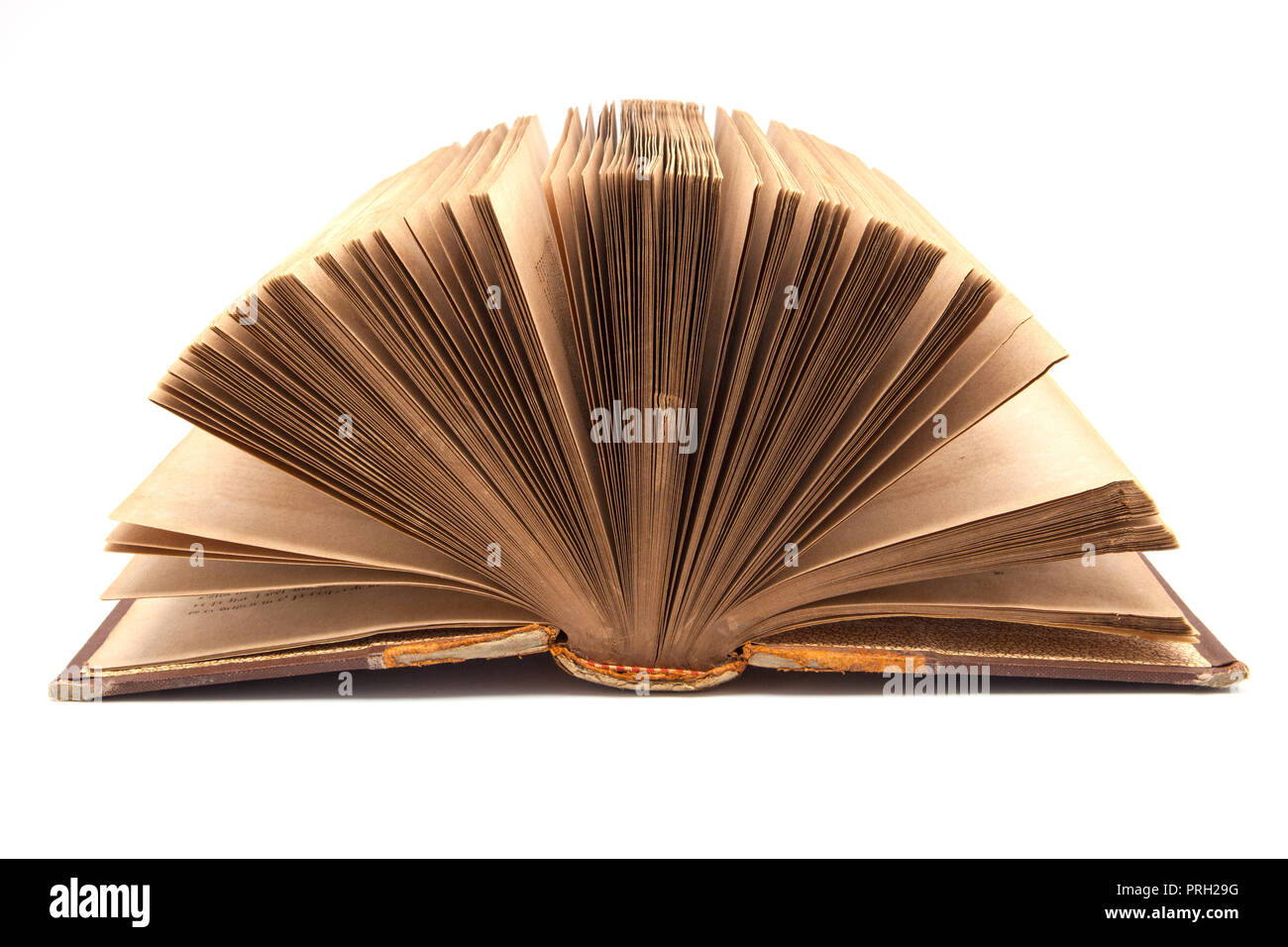 book ancient and worn out on white fund - Stock Image