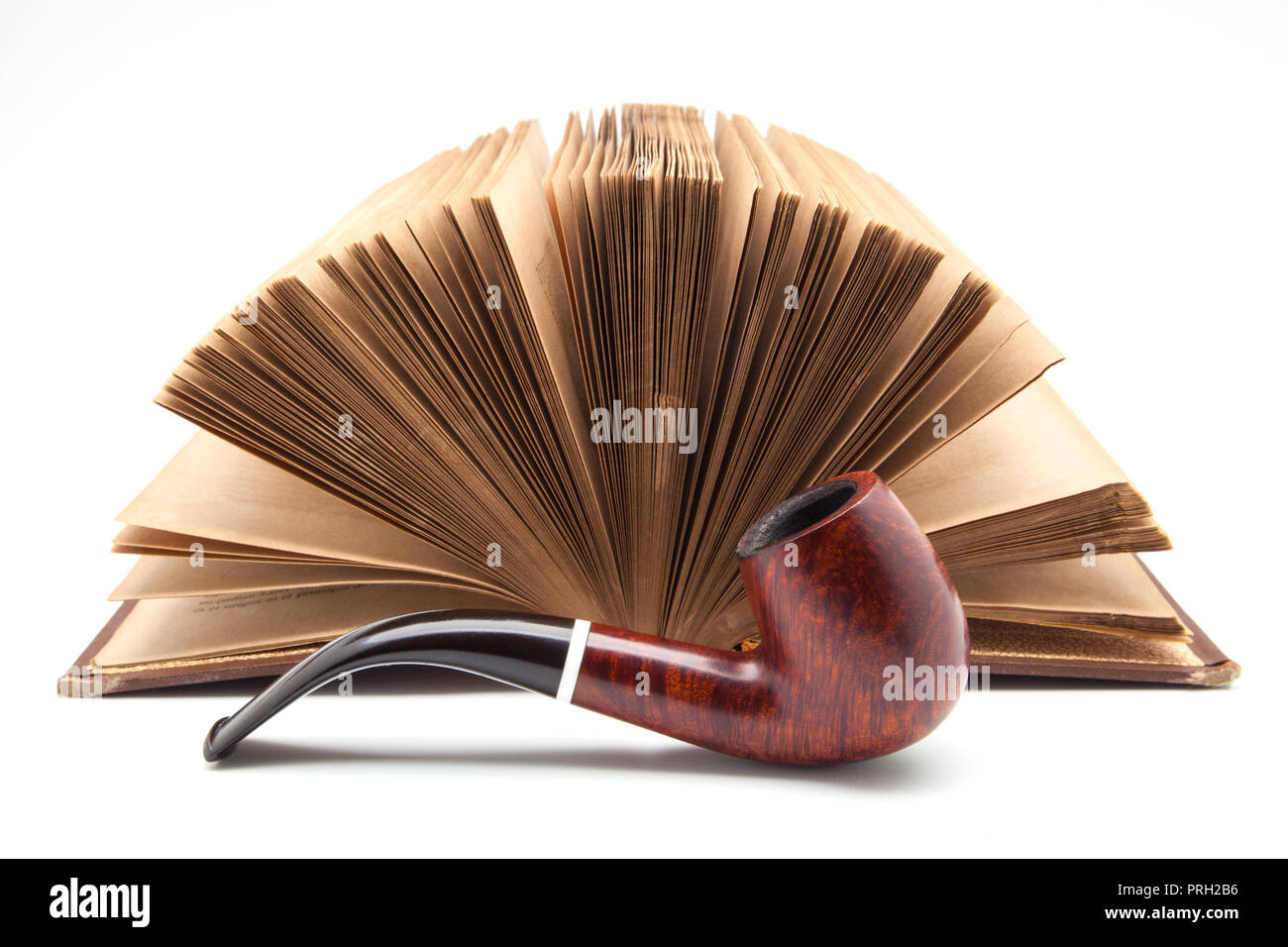 pipe and ancient book on white fund - Stock Image