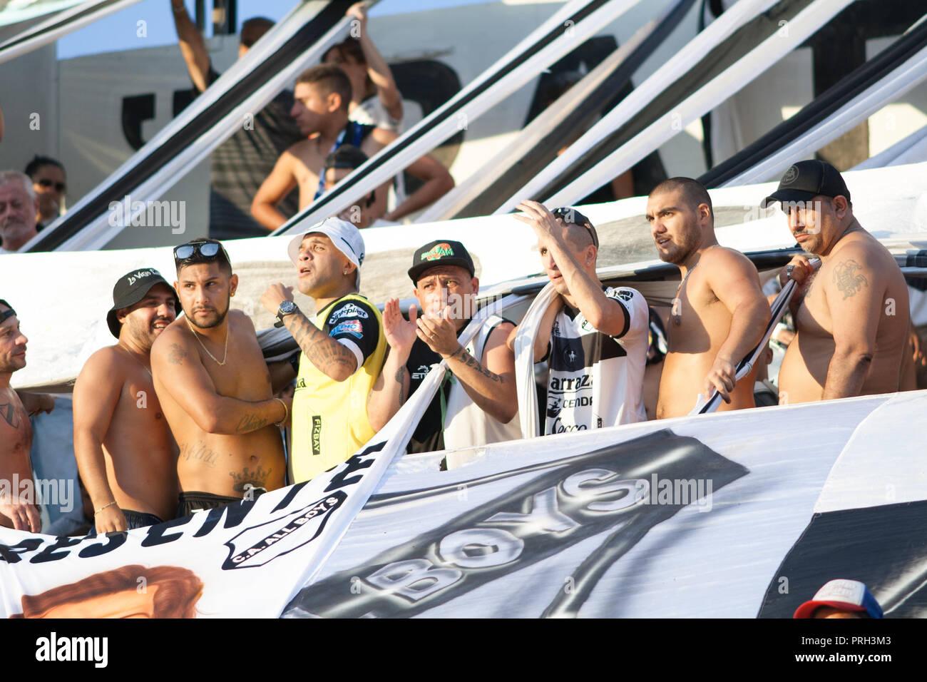 Members of 'La Barra de Muro' during a football match of All Boys. - Stock Image