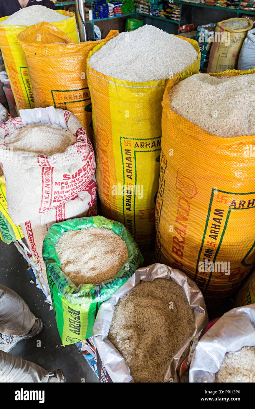 Sacks of rice on sale in shop, Meghalaya, India - Stock Image