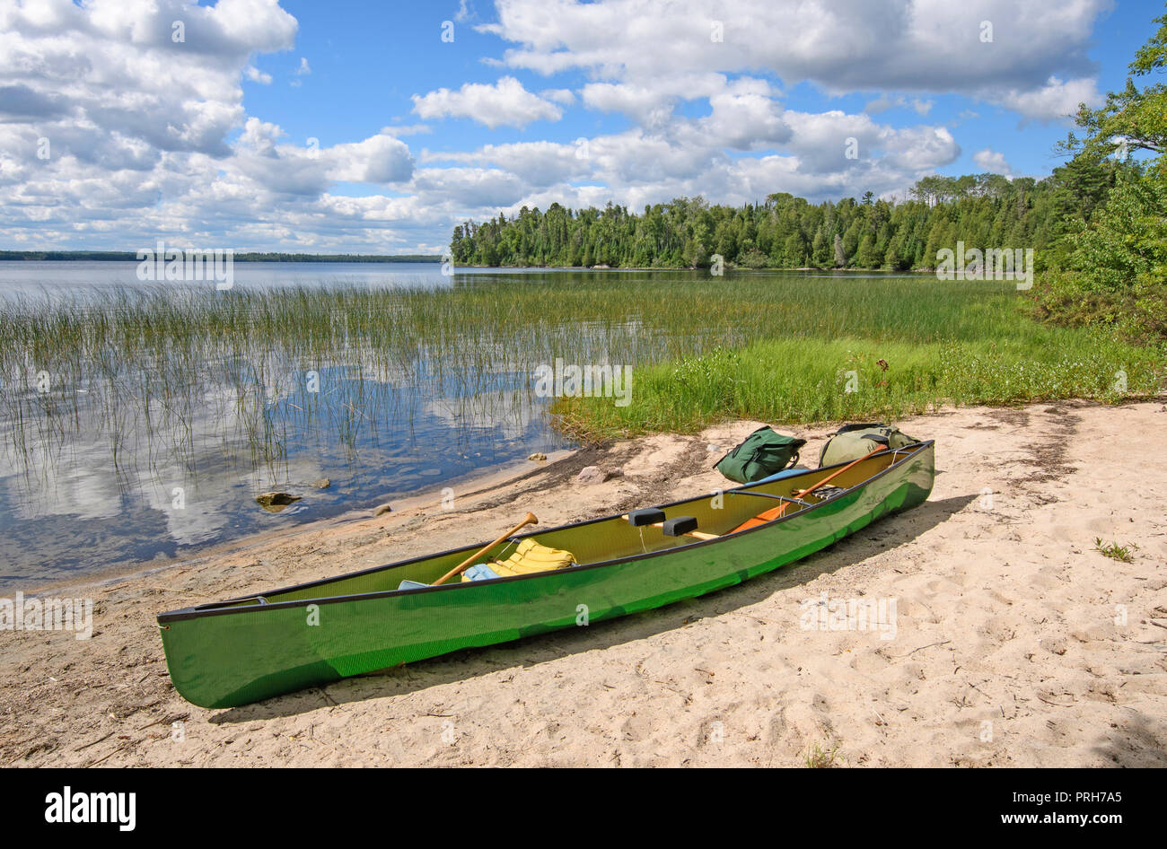 Loading the Canoe on the Shore of Basswood Lake in Quetico Provincila Park in Ontario - Stock Image