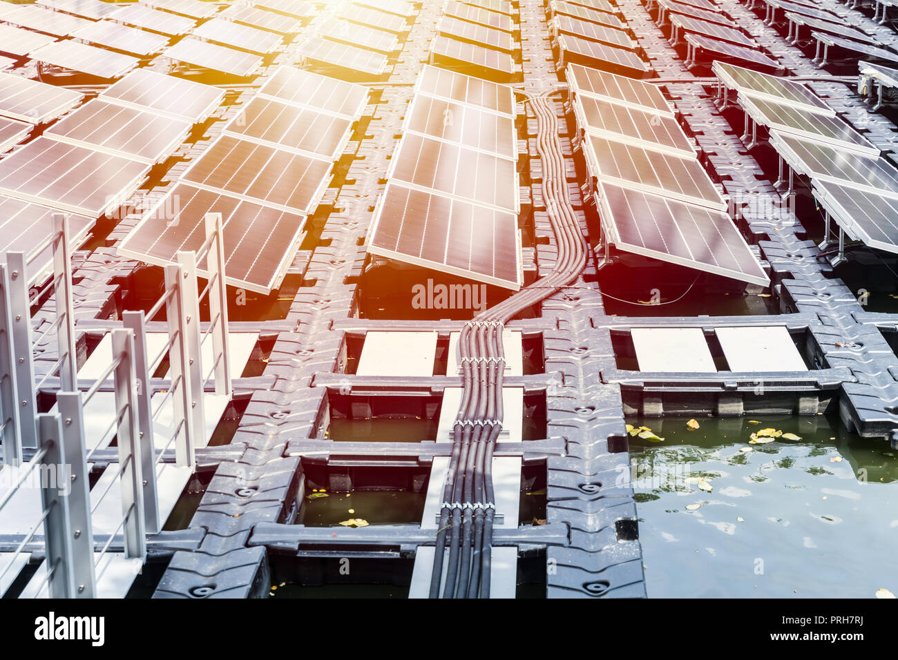 floating solar farm or FPV array of solar panels on water lake river pond - Stock Image