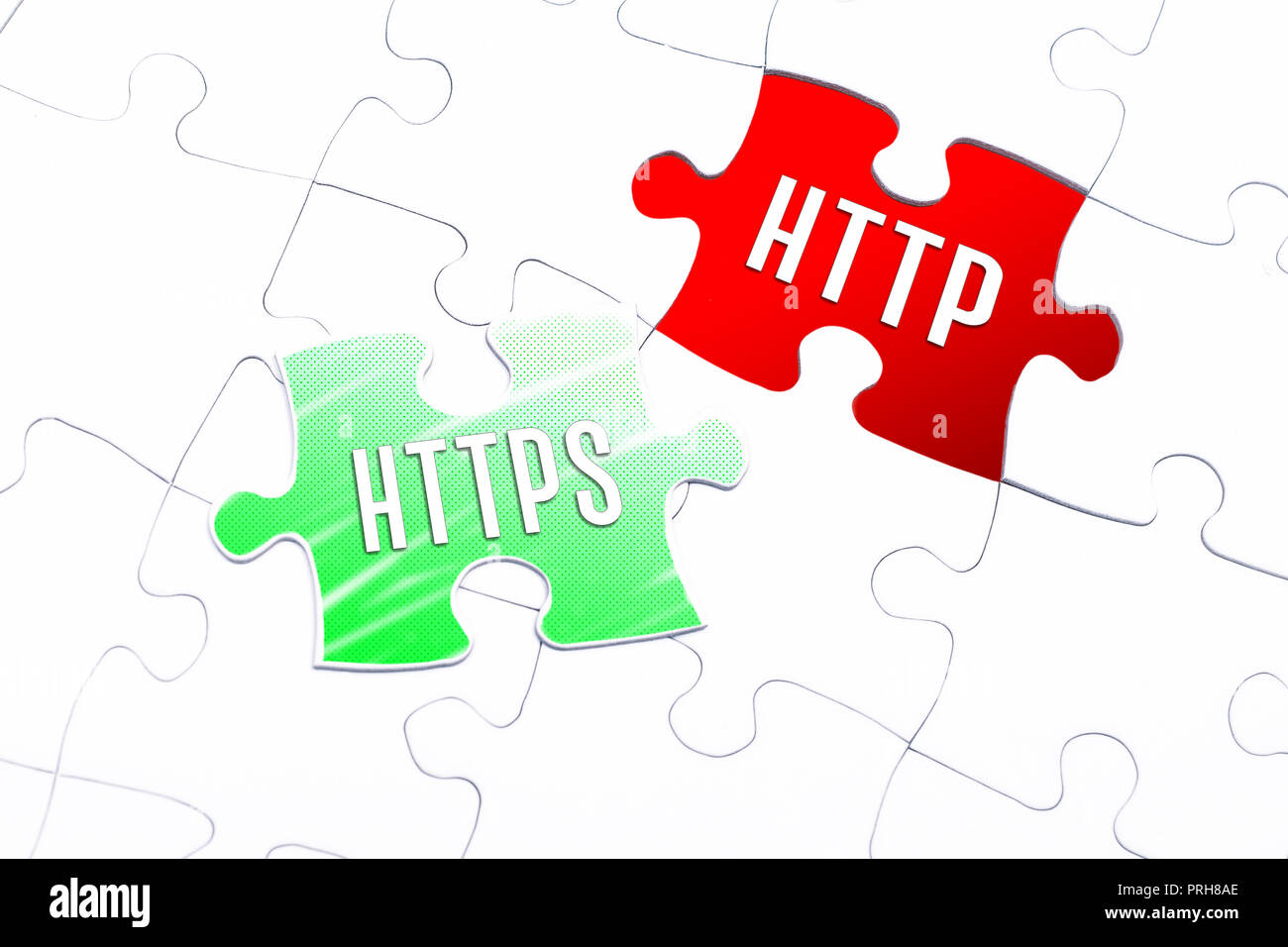 The Words HTTPS And HTTP In A Missing Piece Jigsaw Puzzle - Stock Image