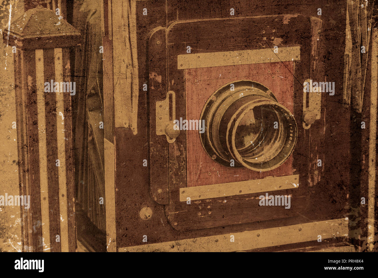 vintage old camera large format closeup front lens with grunge dirty texture. - Stock Image