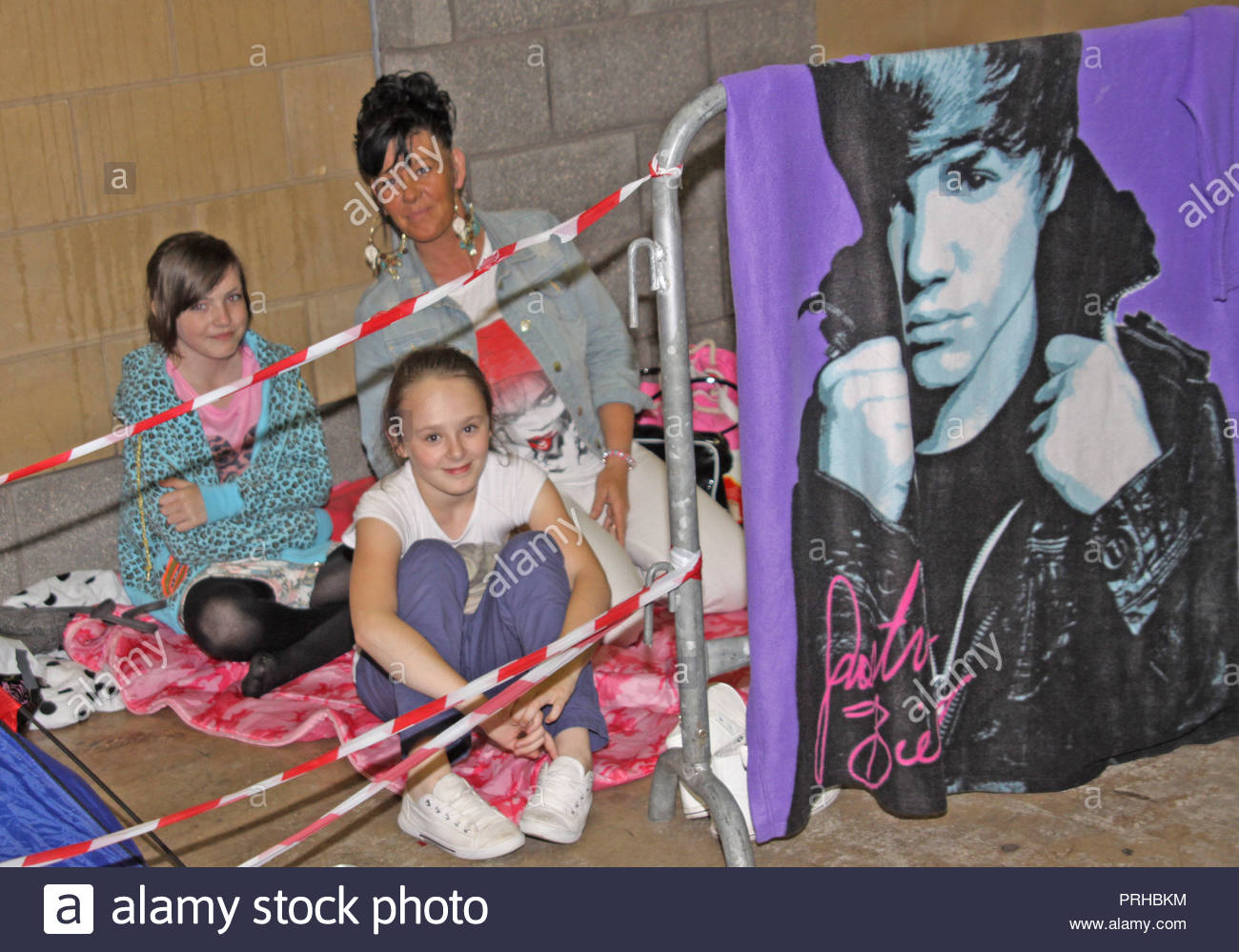 Justin Bieber fans are sleeping outside manchester arena since monday 02 July, waiting for tickets to go on sale this friday 06 July 2012 for his concert on 19 February 2013 photo taken on Wednesday 04 July 2012  the school warden needs to take a trip down to the arena and find out who is bunking off school... - Stock Image