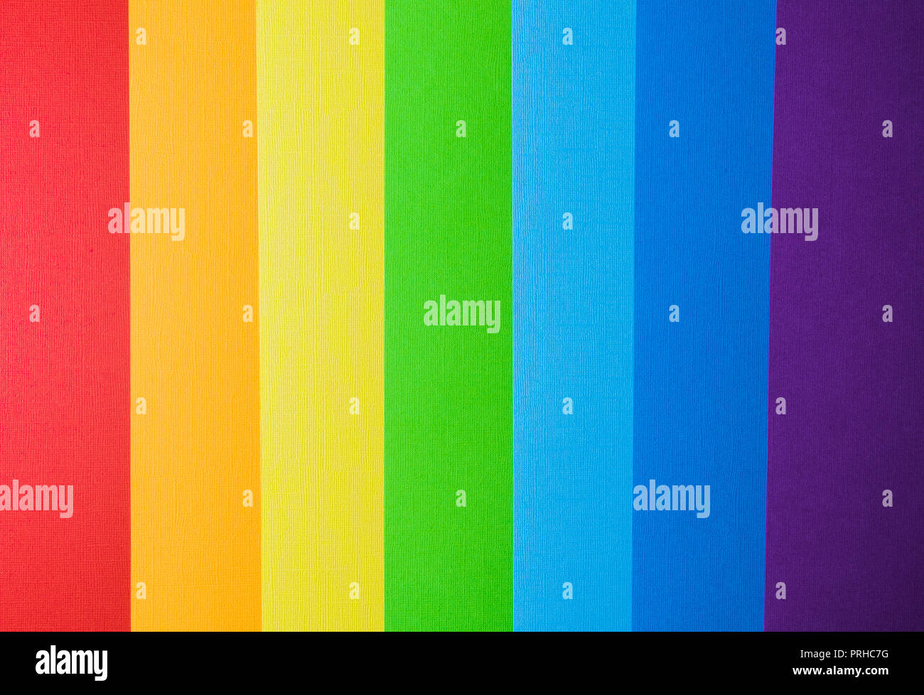 Multi colored abstract paper of rainbow colors , flat lay. Stock Photo