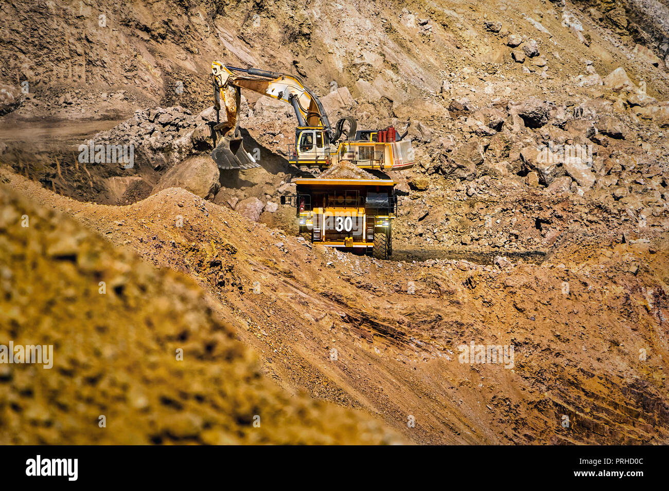 An open pit diamond mine in Botswana with heavy machinery on site. - Stock Image