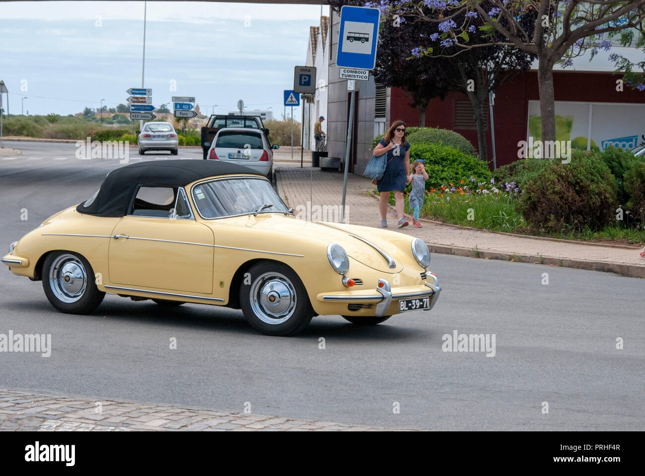 Cream Yellow 1950's Porsche 356 A Convertible Vintage Sportscar front right passenger view of yellow cream colour porsche 356A convertible soft top ra - Stock Image