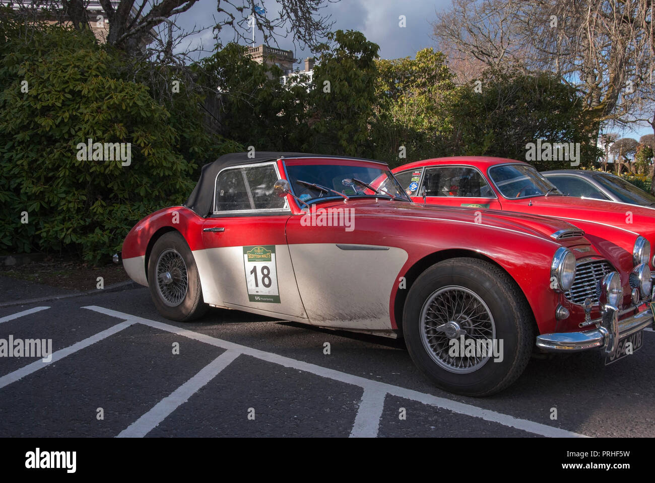 Red & White  Austin Healey 3000 100/6 Sports Car front right hand drivers side offside view of red and white right hand drive two door british convert - Stock Image
