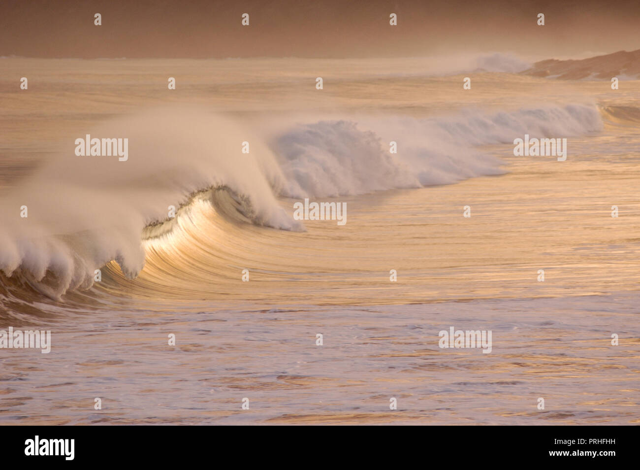 Waves at sunset - Stock Image