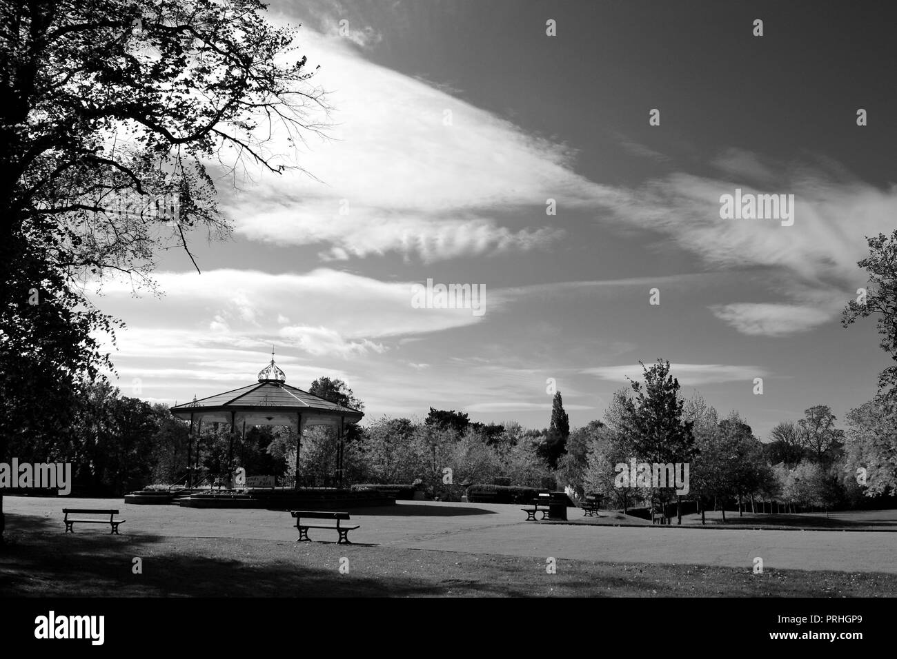 Black and White moody images of the traditional Bandstand at Ropner Park, Stockton-on-Tees on a sunny Autumn afternoon. - Stock Image