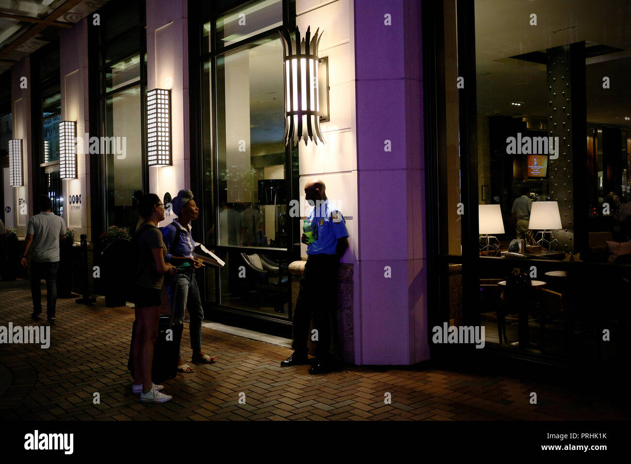 Houston, Texas - June 20, 2016: Unidentified girls selling food to an Unidentified police in Downtown Houston, Texas - Stock Image