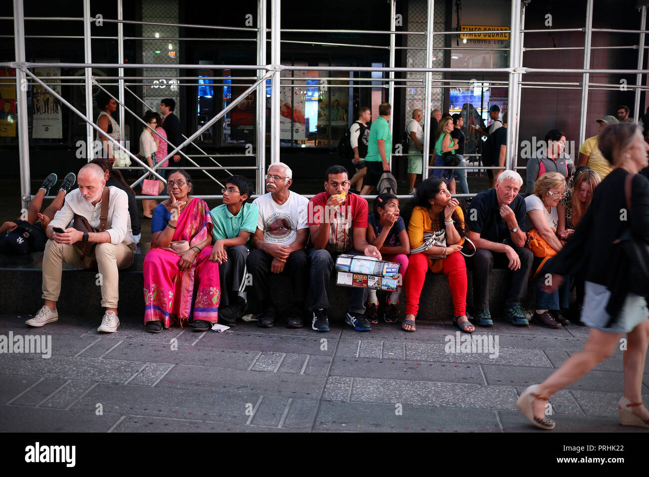 New York, Usa - June 24, 2018: Family eating in middle of Times Square, New York City - Stock Image