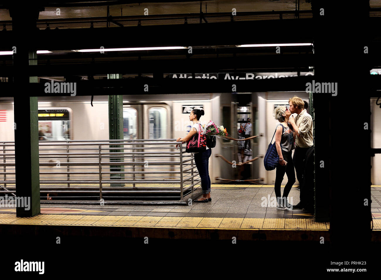 Brooklyn, New York - June 28, 2018: Unidentified couple kissing each other in a Brooklyn station in New York, Usa - Stock Image