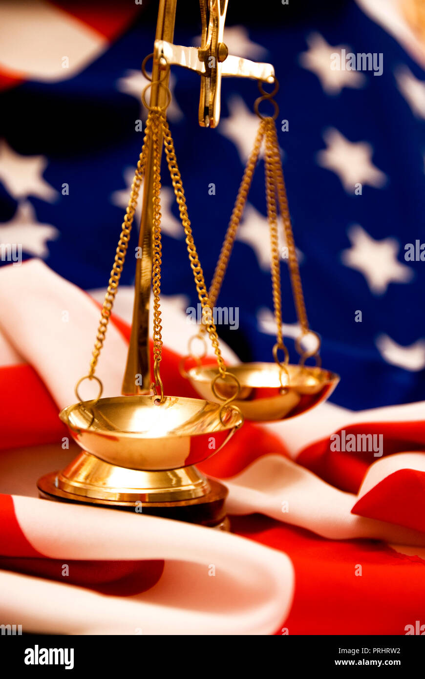 scales and USA flag concept for justice in United States of America - Stock Image