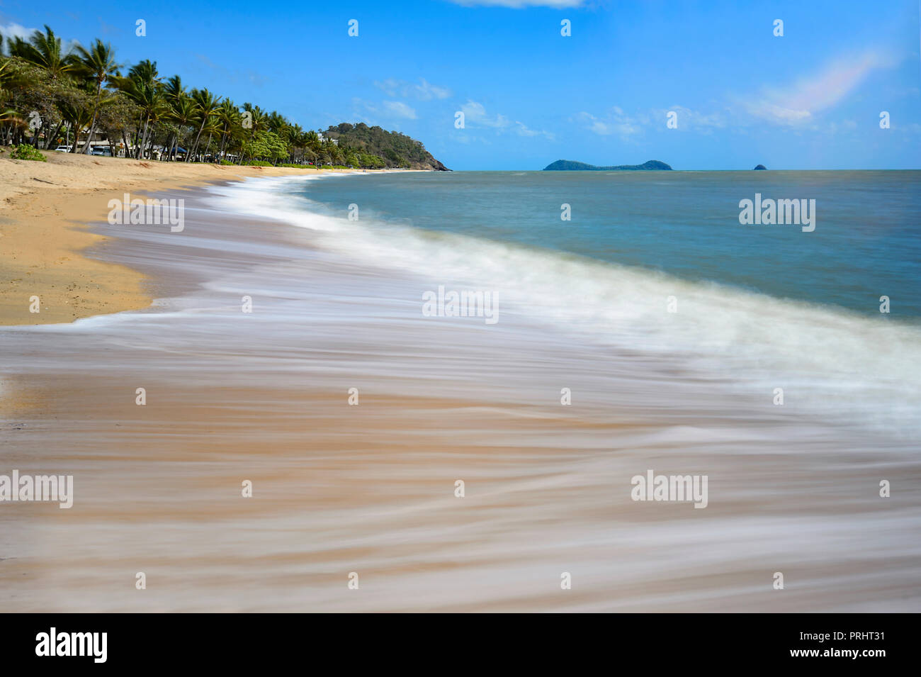 Motion blur of lapping waves at the scenic exotic Trinity Beach, Cairns Northern Beaches, Far North Queensland, FNQ, QLD, Australia - Stock Image