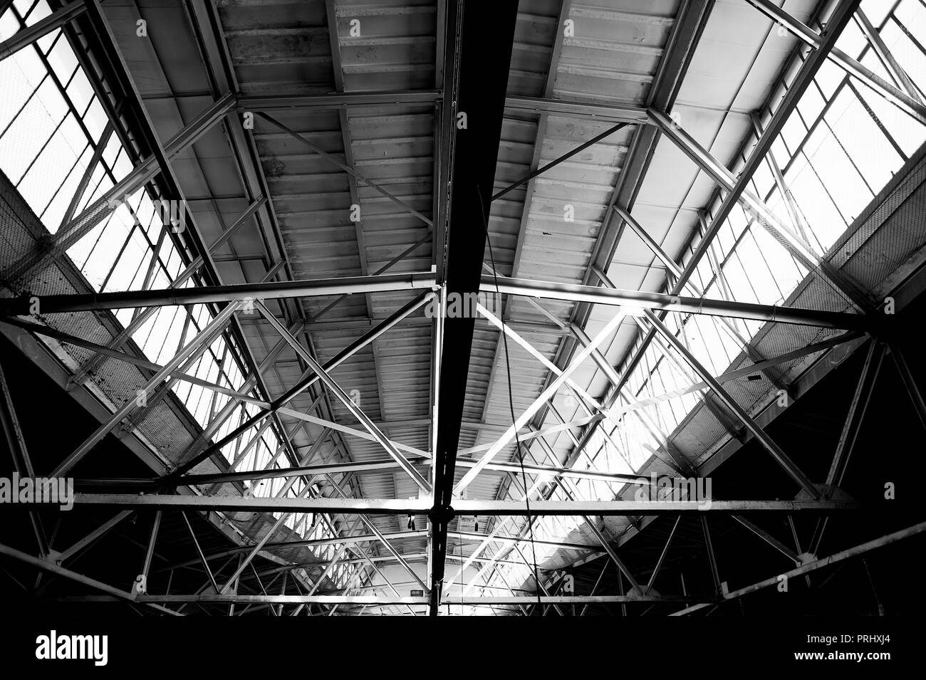 The roof of the old factory of metal and glass. That was a lot of light.Large-scale design - Stock Image