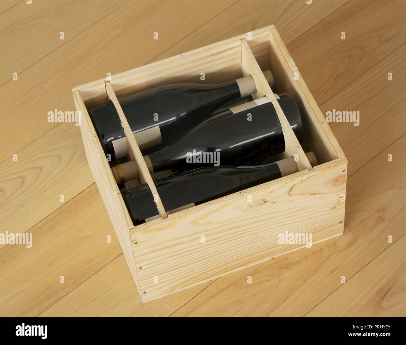 Red Wine Bottles Packed In Open Wooden Box Standing On Wood Floor