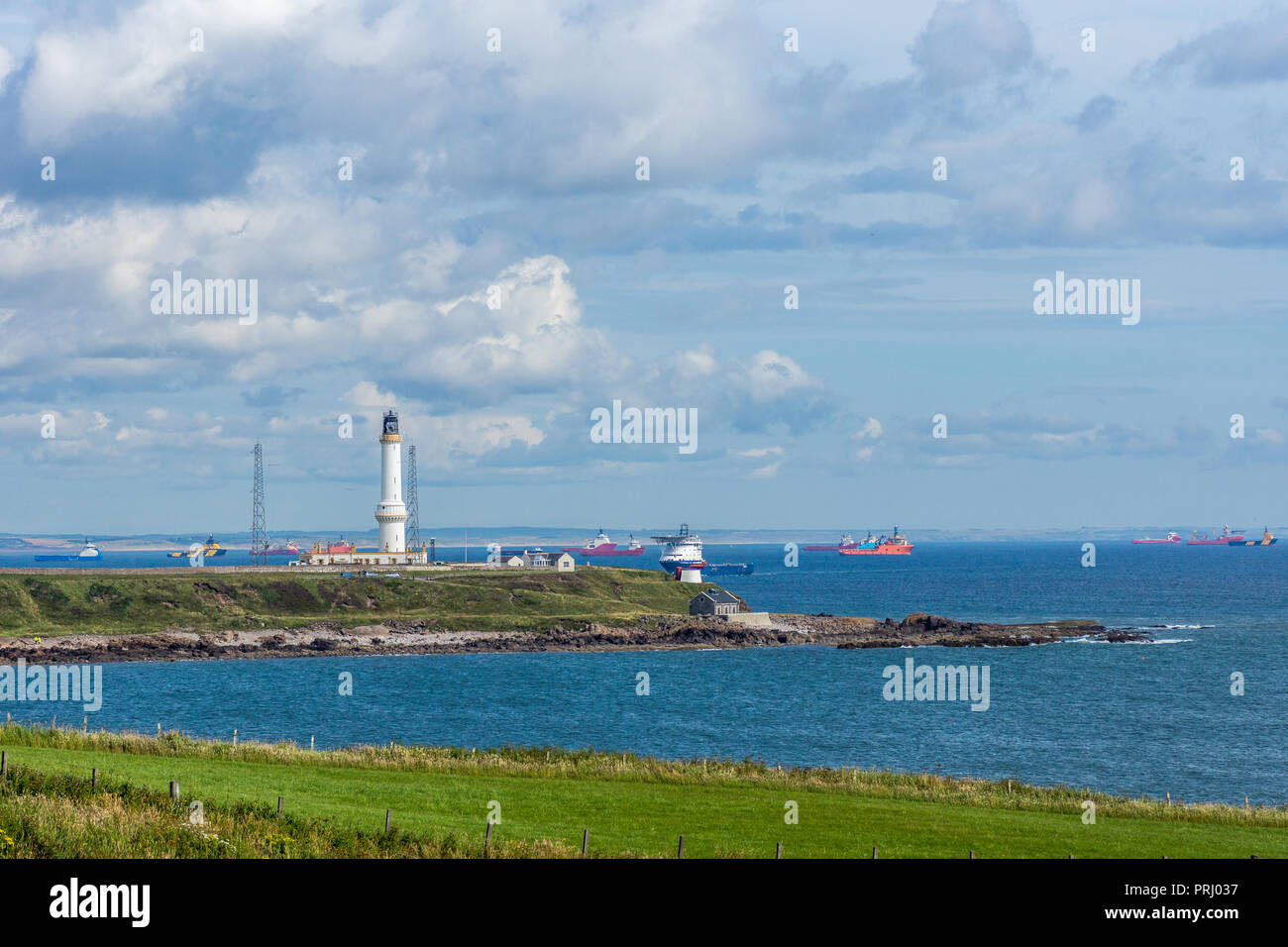 Girdleness Lighthouse and Aberdeen Bay with lots of oil tugs. - Stock Image