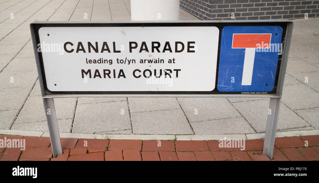 Part bilingual Canal Parade road name sign near Dumballs Road commemorating former canal nearby - Stock Image