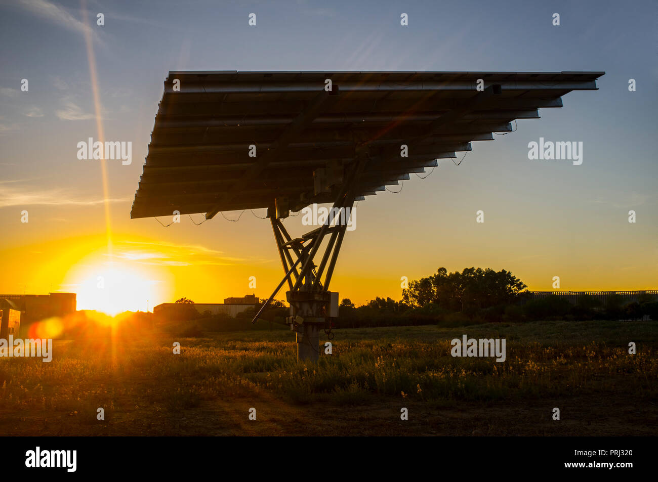 Urban photovoltaic panel with solar tracker placed outdoors building - Stock Image