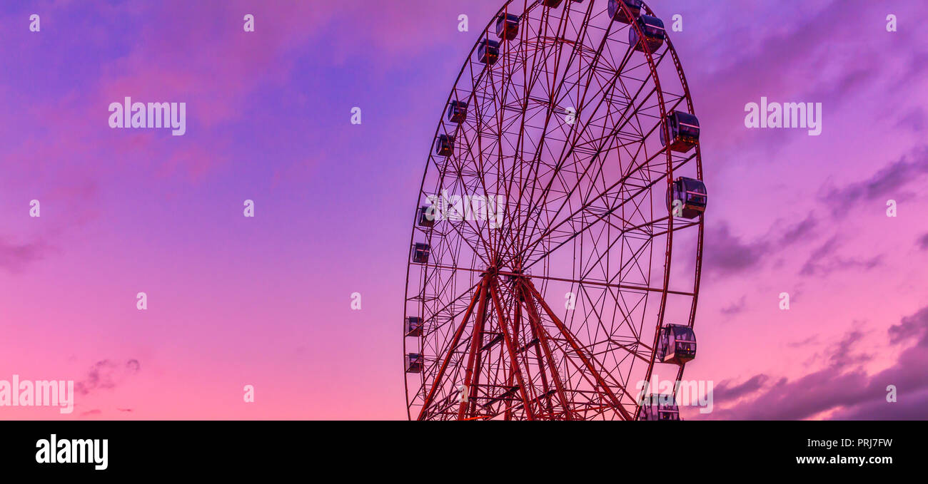 Detail And Silhouette of Ferris Wheel with Sun Set - Stock Image
