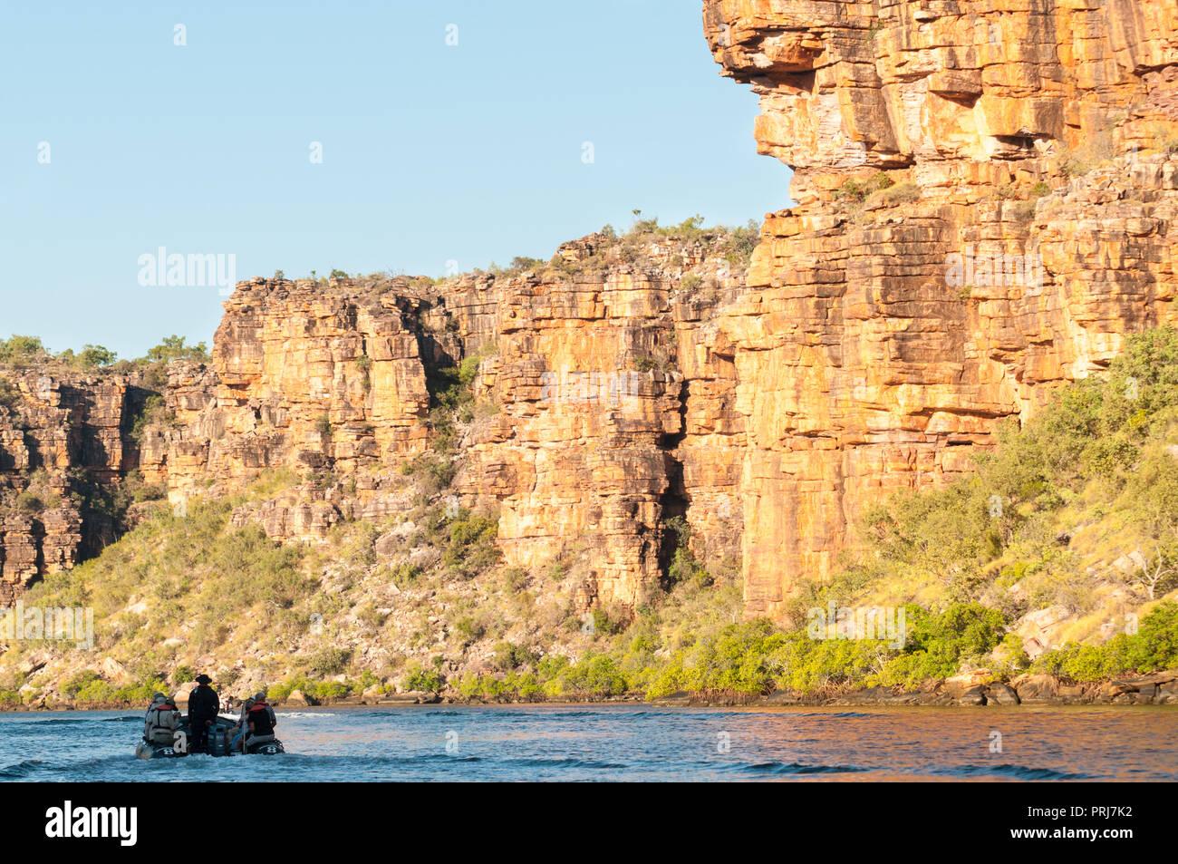 Inflatable Rubber Boat cruising King George River Gorge, Kimberley Coast, Australia - Stock Image