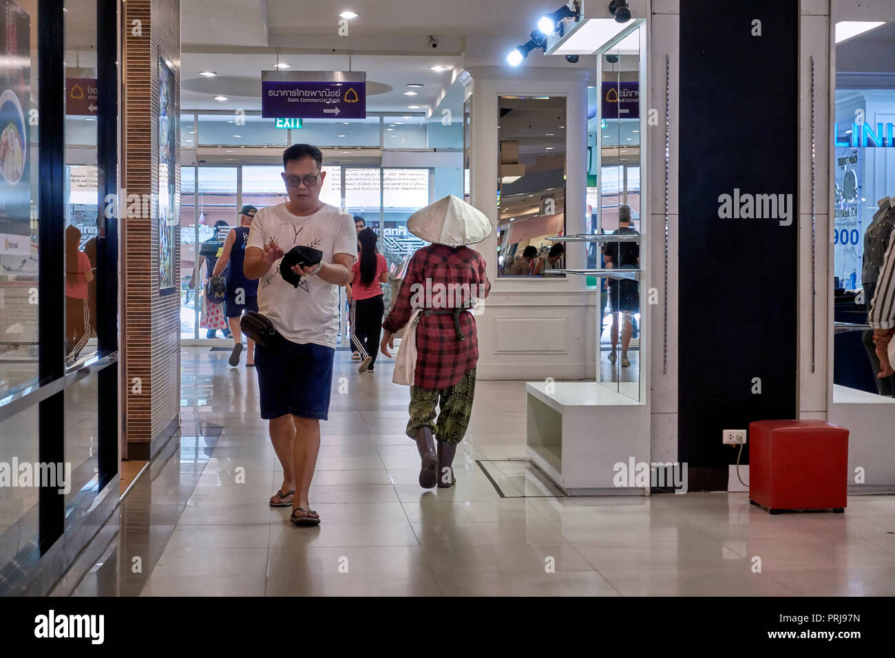 Thailand shopping mall interior with both city and rural shoppers providing an example of contrasting lifestyles.  Southeast Asia - Stock Image