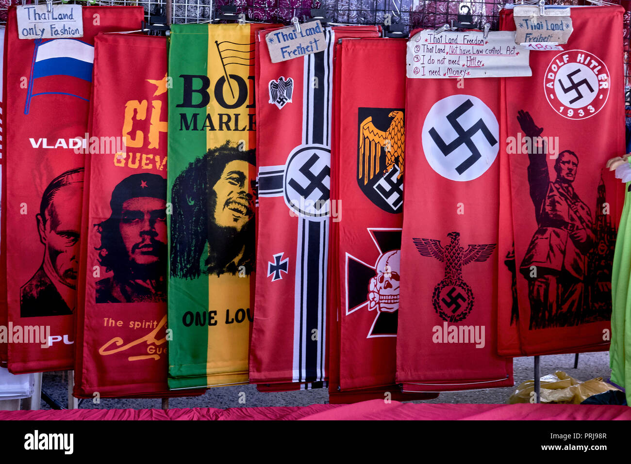 Nazi memorabilia and propaganda banners on sale at a Thailand market. Pattaya Southeast Asia. The vendor is aware of the controversy - Stock Image
