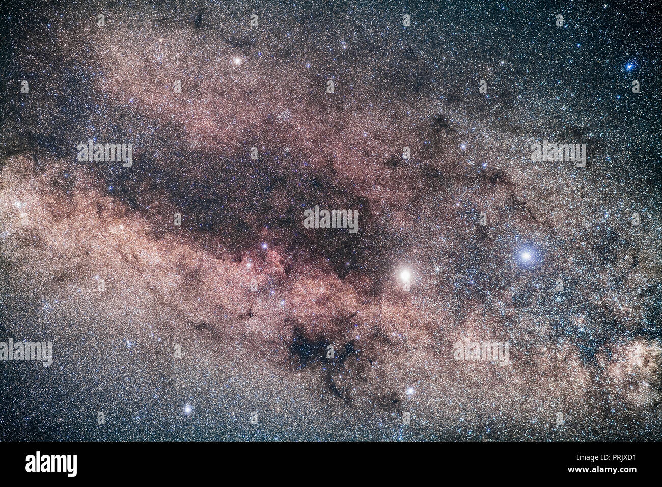 The bright stars Alpha Centauri (left) and Beta Centauri (right) at the end of the dark lanes of Centaurus in the southern Milky Way. The star cluster - Stock Image