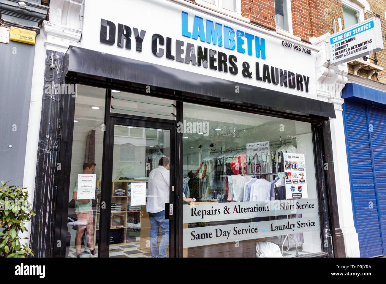 London England United Kingdom Great Britain Lambeth North Kennington Road Lambeth Dry Cleaners and Laundry exterior storefront repairs alterations same day service signage window - Stock Image