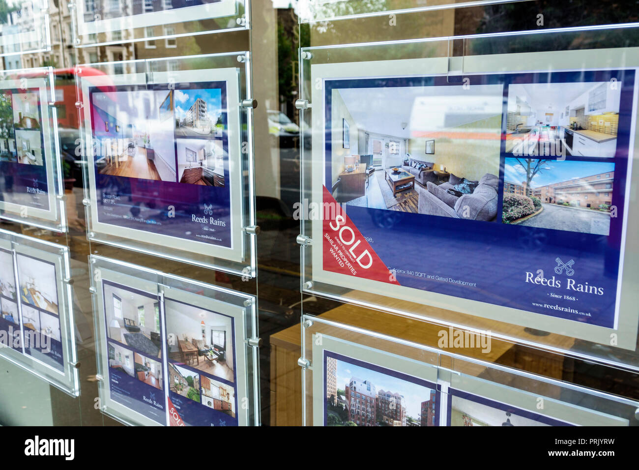 London England United Kingdom Great Britain Lambeth North Kennington Road Reeds Rains real estate office flats apartments for sale sold window display - Stock Image