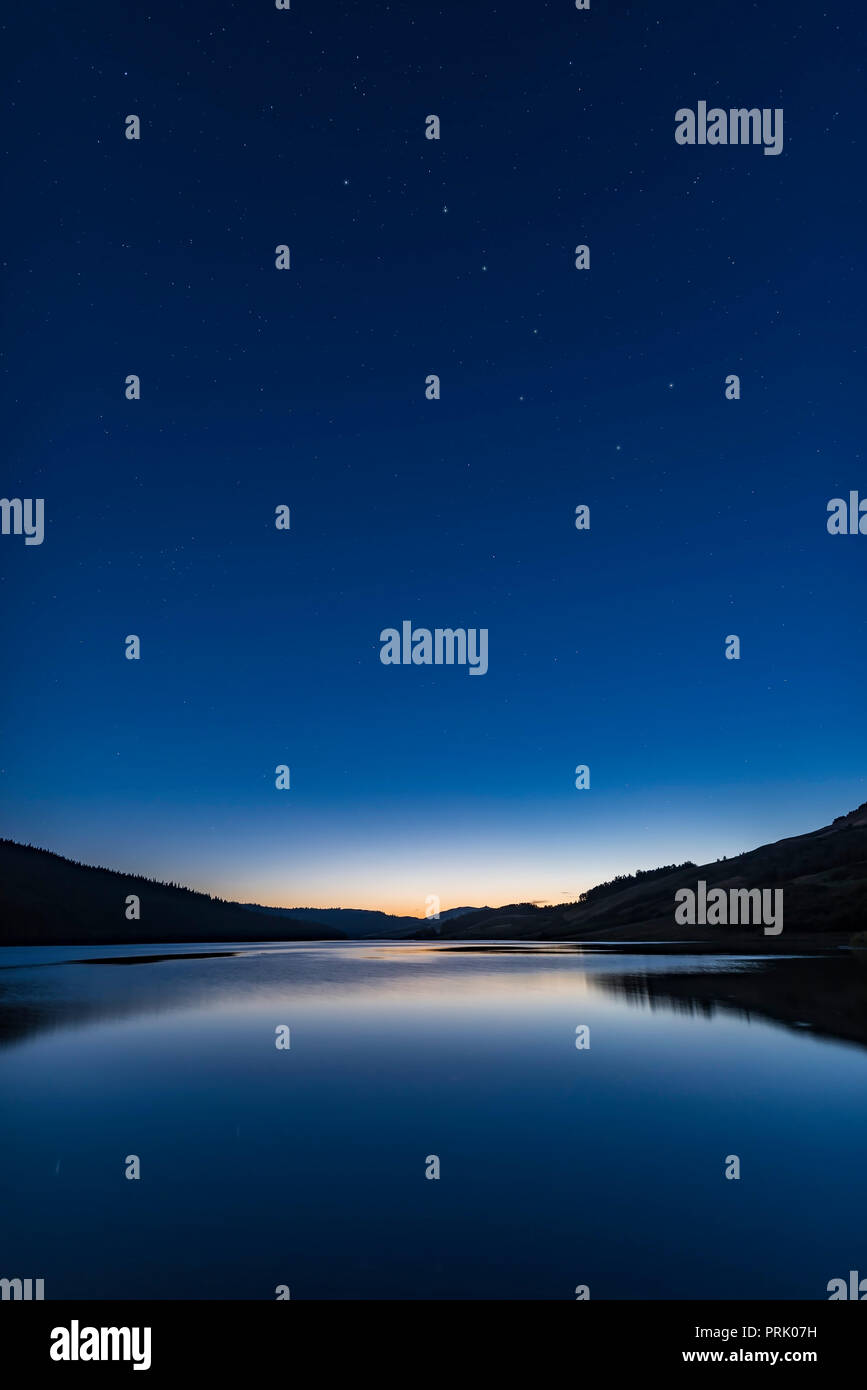 The Big Dipper in deep sunset twilight over Reesor Lake in the Cypress Hills of southeast Alberta. Taken July 28, 2017.   This is a single exposure wi - Stock Image