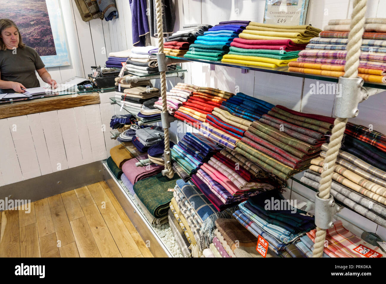 London England United Kingdom Great Britain Bloomsbury Highland Store Scottish Shop shopping lambswool cashmere scarf scarves display sale woman sales - Stock Image