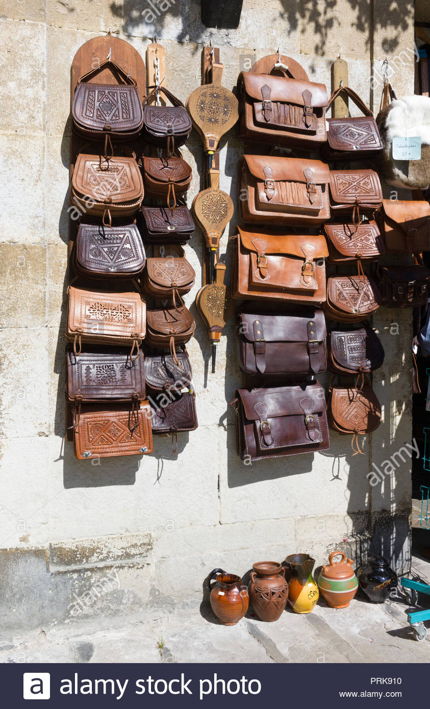 Leather goods and handbags for sale in a gift shop in Santillana del Mar, Cantabria, Spain Stock Photo