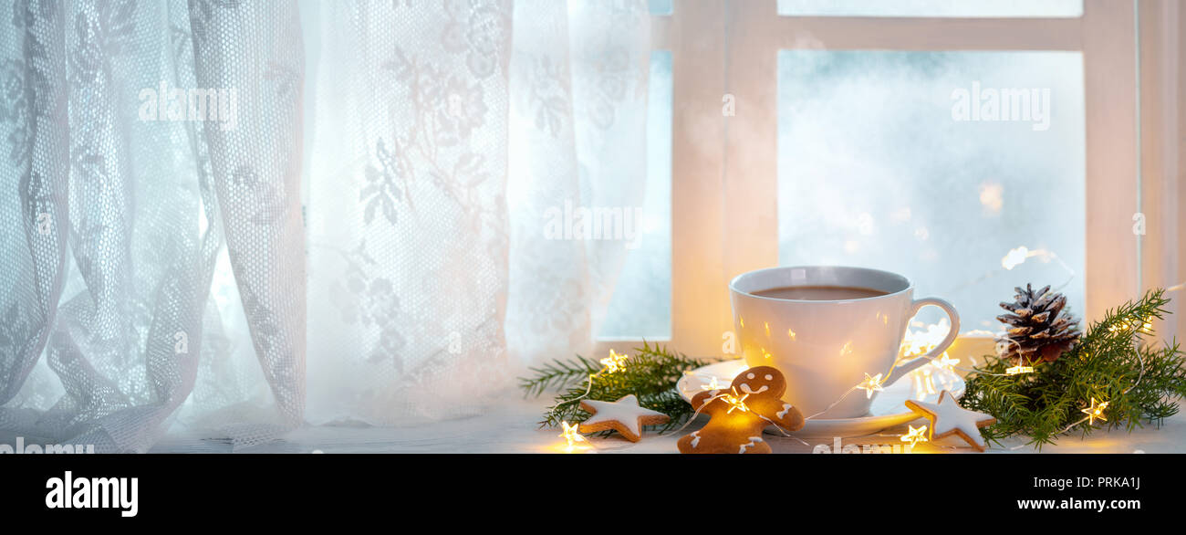 Merry Christmas and happy holidays Window with a cup of hot drink,new year decoration. - Stock Image