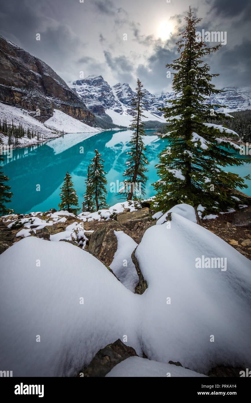 Moraine Lake is a glacially fed lake in Banff National Park, 14 kilometres (8.7 mi) outside the Village of Lake Louise, Alberta, Canada. Stock Photo